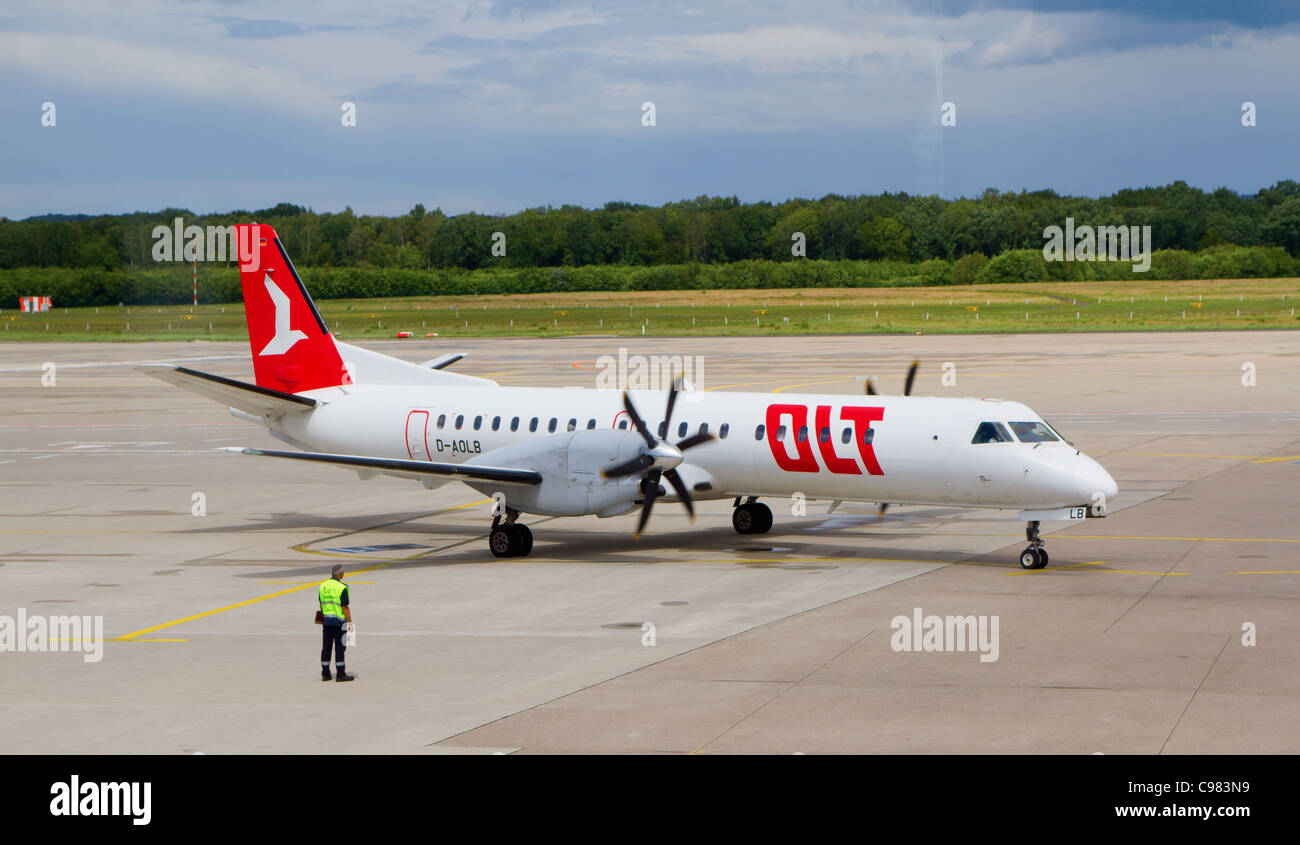 An OLT SAAB 2000 in Bonn-Cologne airport. OLT is small company which operates localy in Germany. - Stock Image