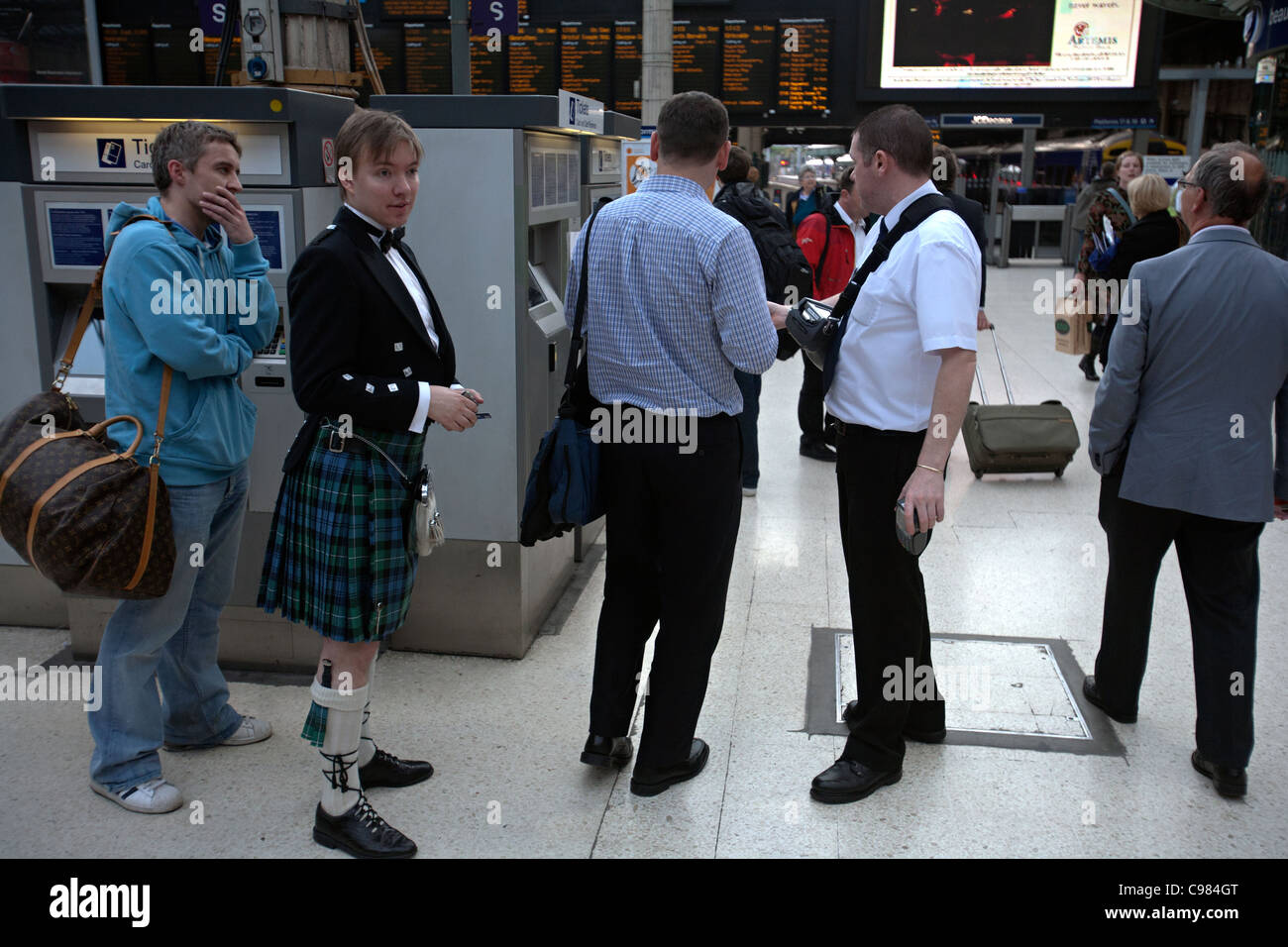 train ticket buyers at  waverley station edinburgh - Stock Image