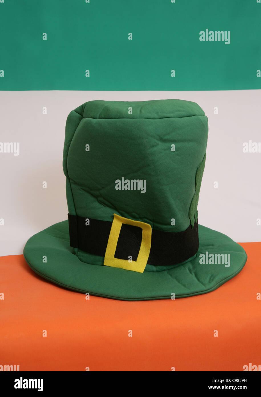 St patricks day hat on and irish flag - Stock Image