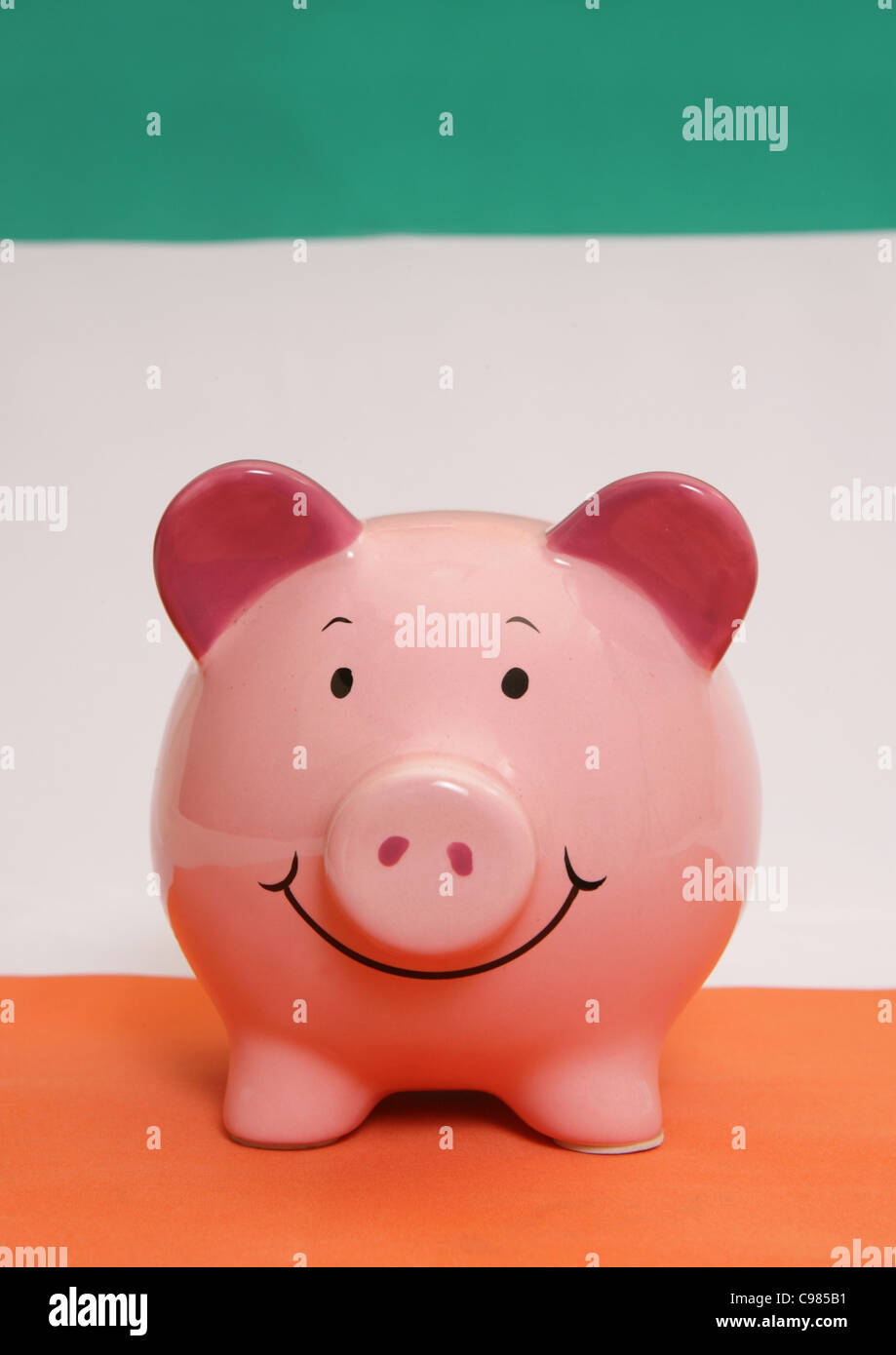 Piggybank on an irish flag - Stock Image