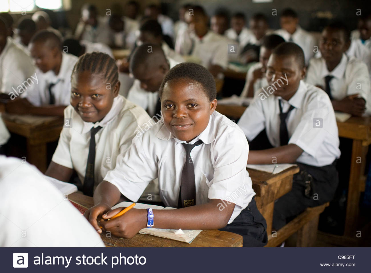Secondary school students studying at their desks at Lunyu Secondary School. - Stock Image