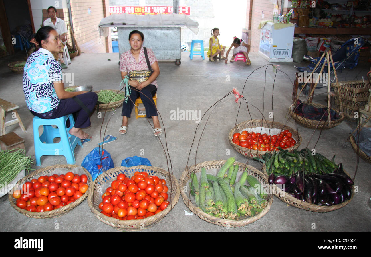 Vegetables in carry baskets at a market in Fengdu, China Stock Photo