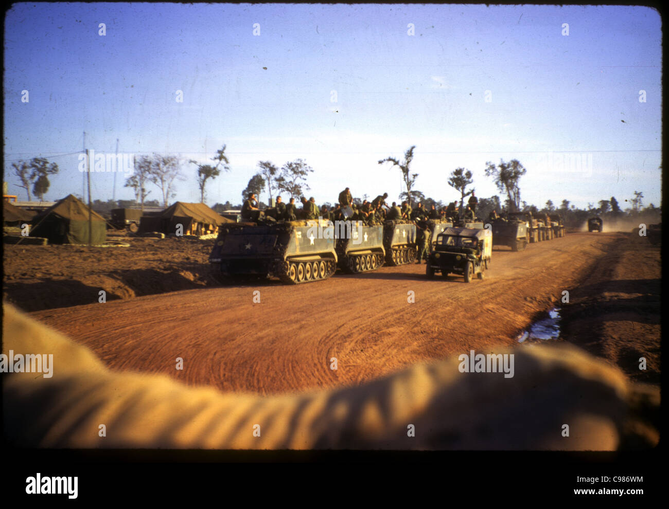 9th Infantry Division arriving in Vietnam APC M113 armored personnel carrier troops soldiers on road waiting - Stock Image