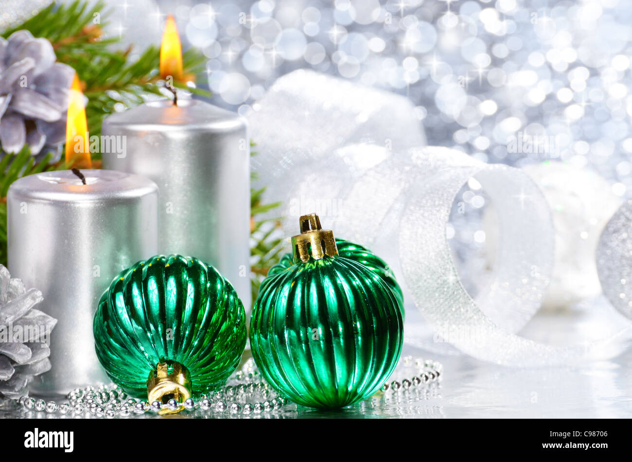 Christmas balls with silver candles over bright background Stock Photo