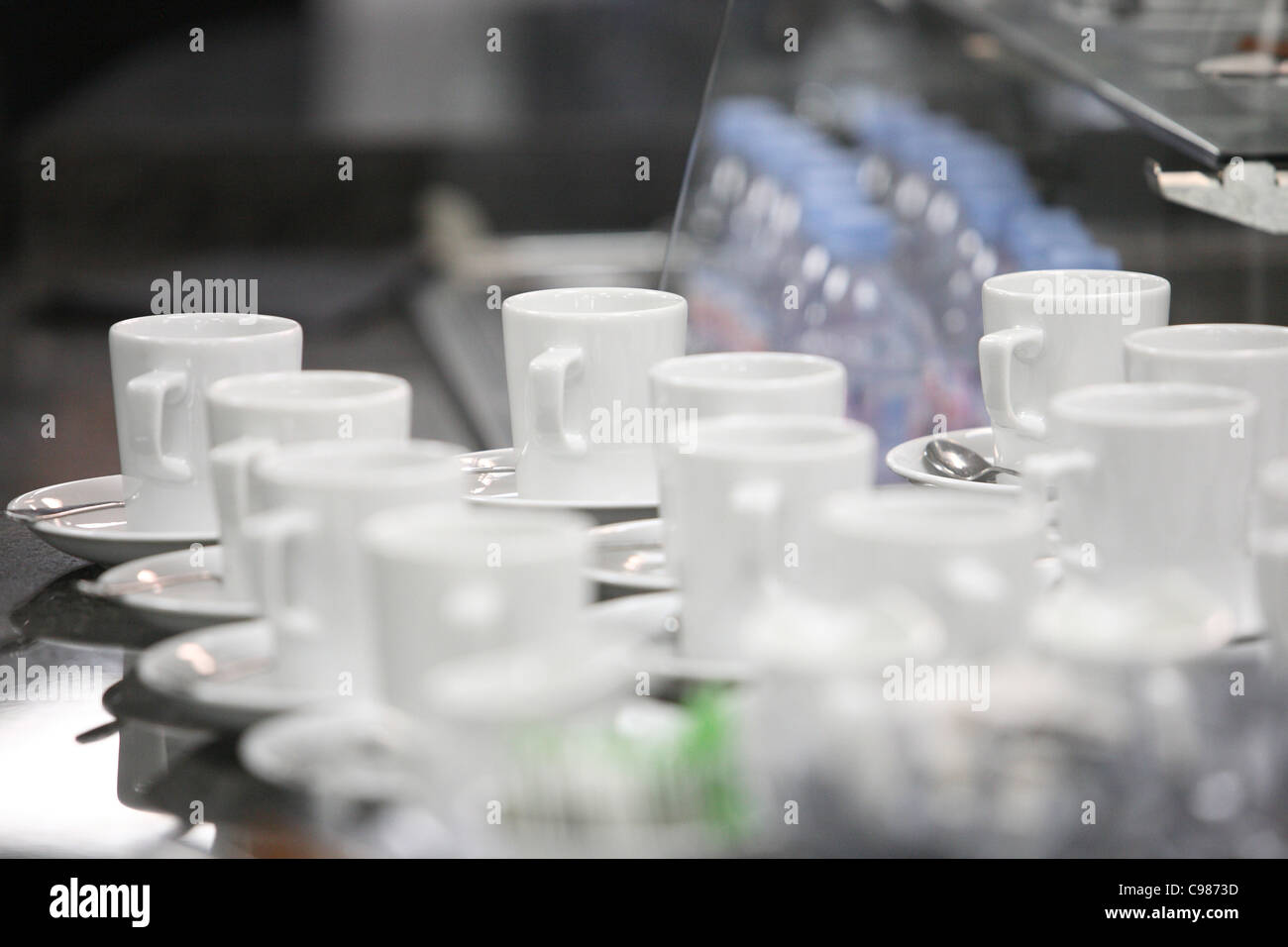 Cups and saucers on counter top - Stock Image