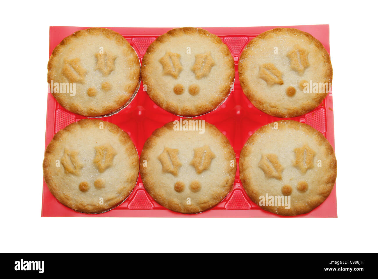 Christmas themed mince pies in a red plastic tray isolated against white - Stock Image