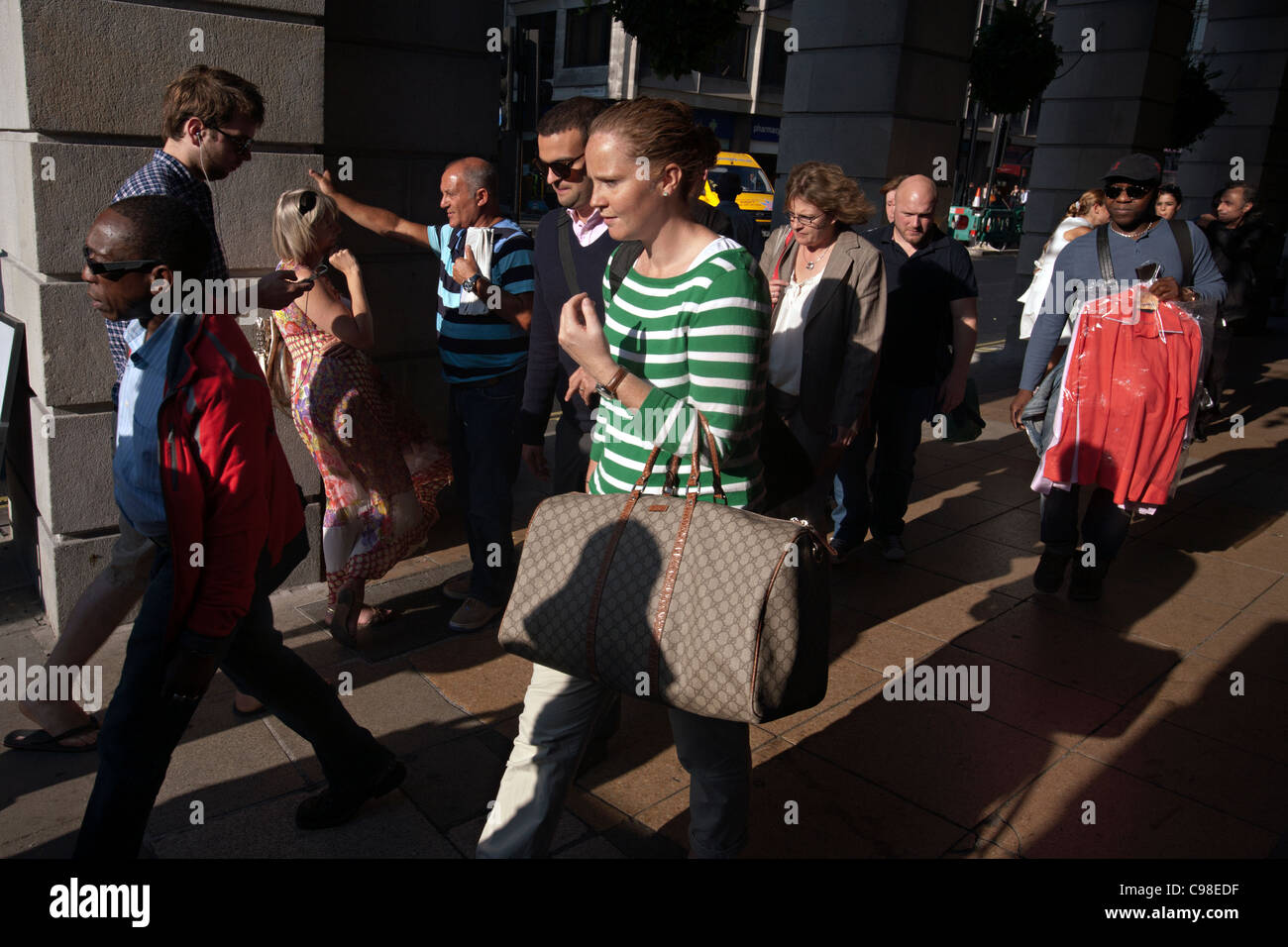 crowd of people in piccadilly london - Stock Image