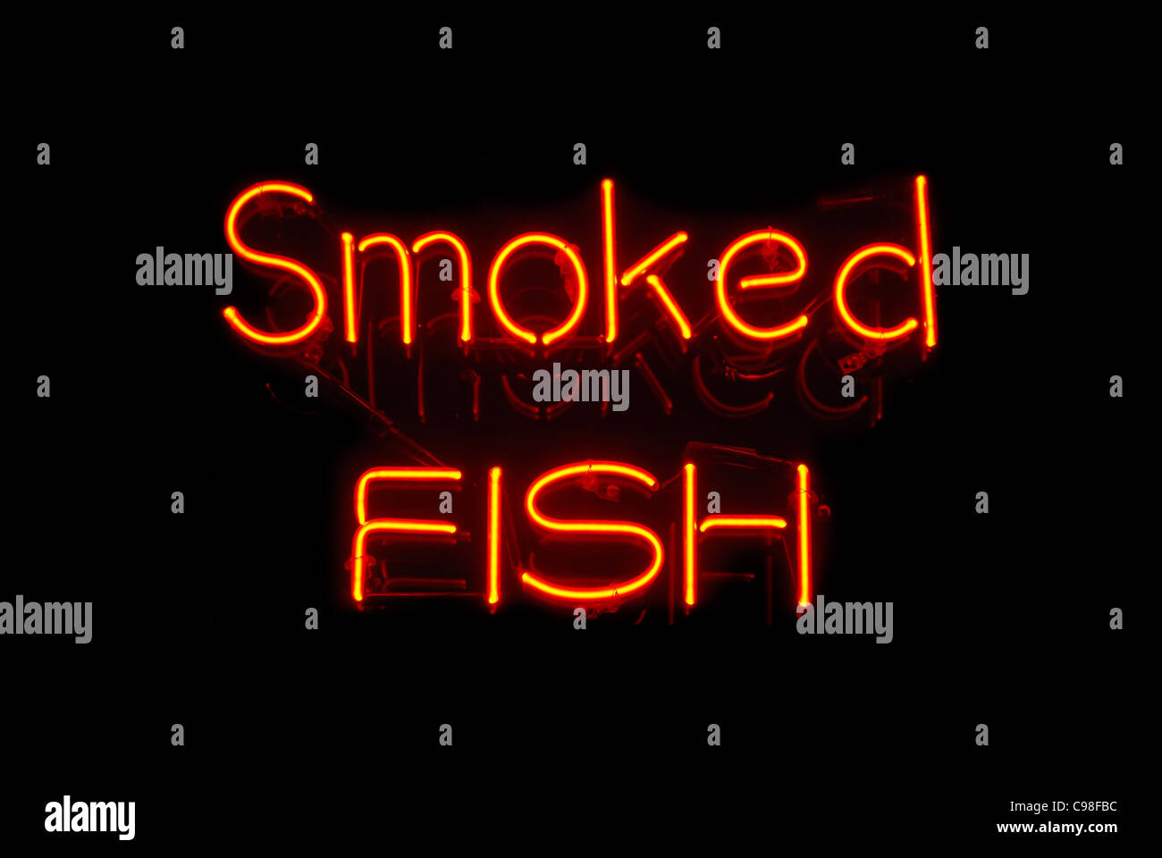 Smoked Fish neon sign isolated on black background - Stock Image