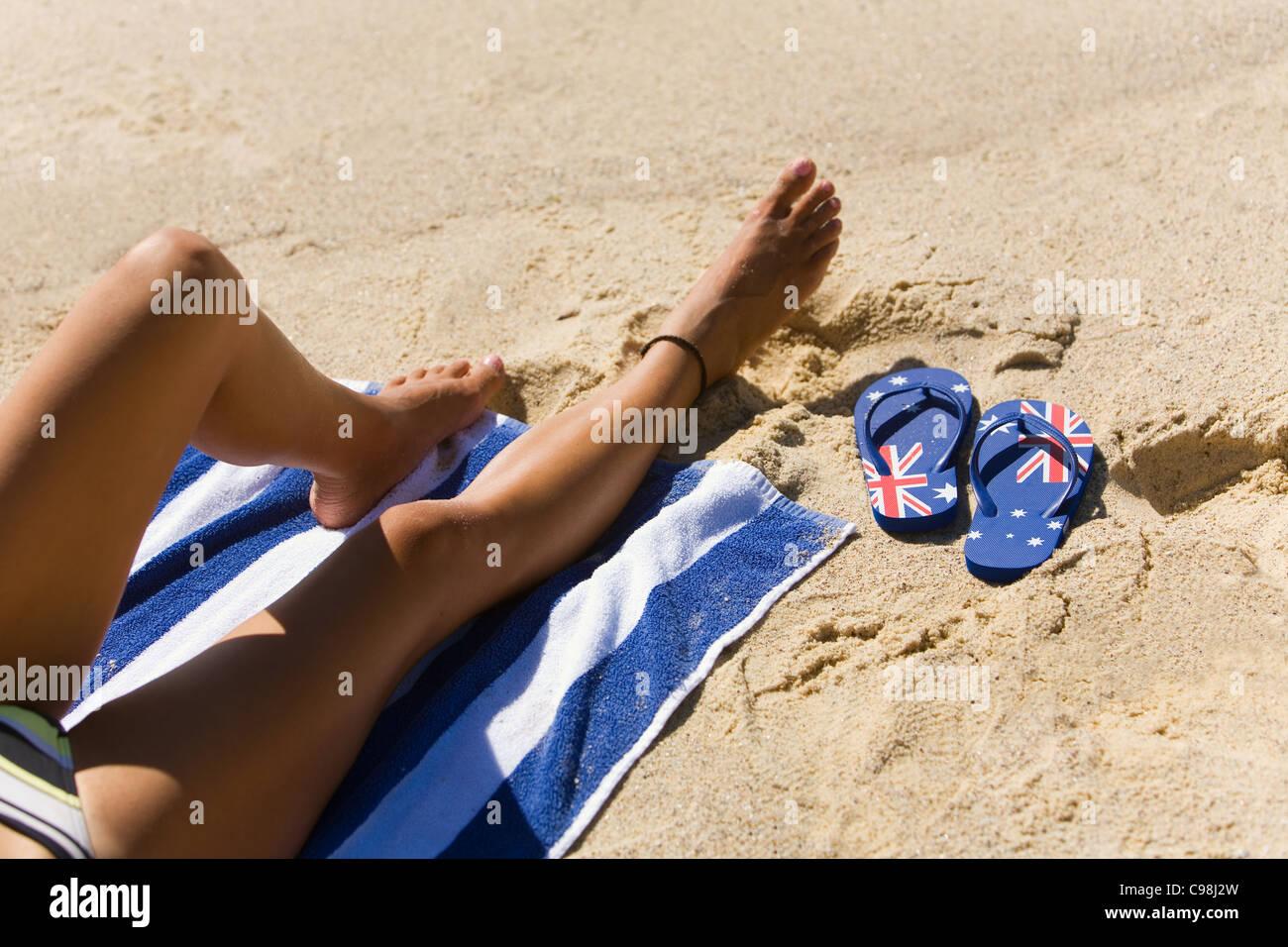 339eeffc2ab266 Sunbather on the beach with Australian flag flip flops. Bondi Beach ...