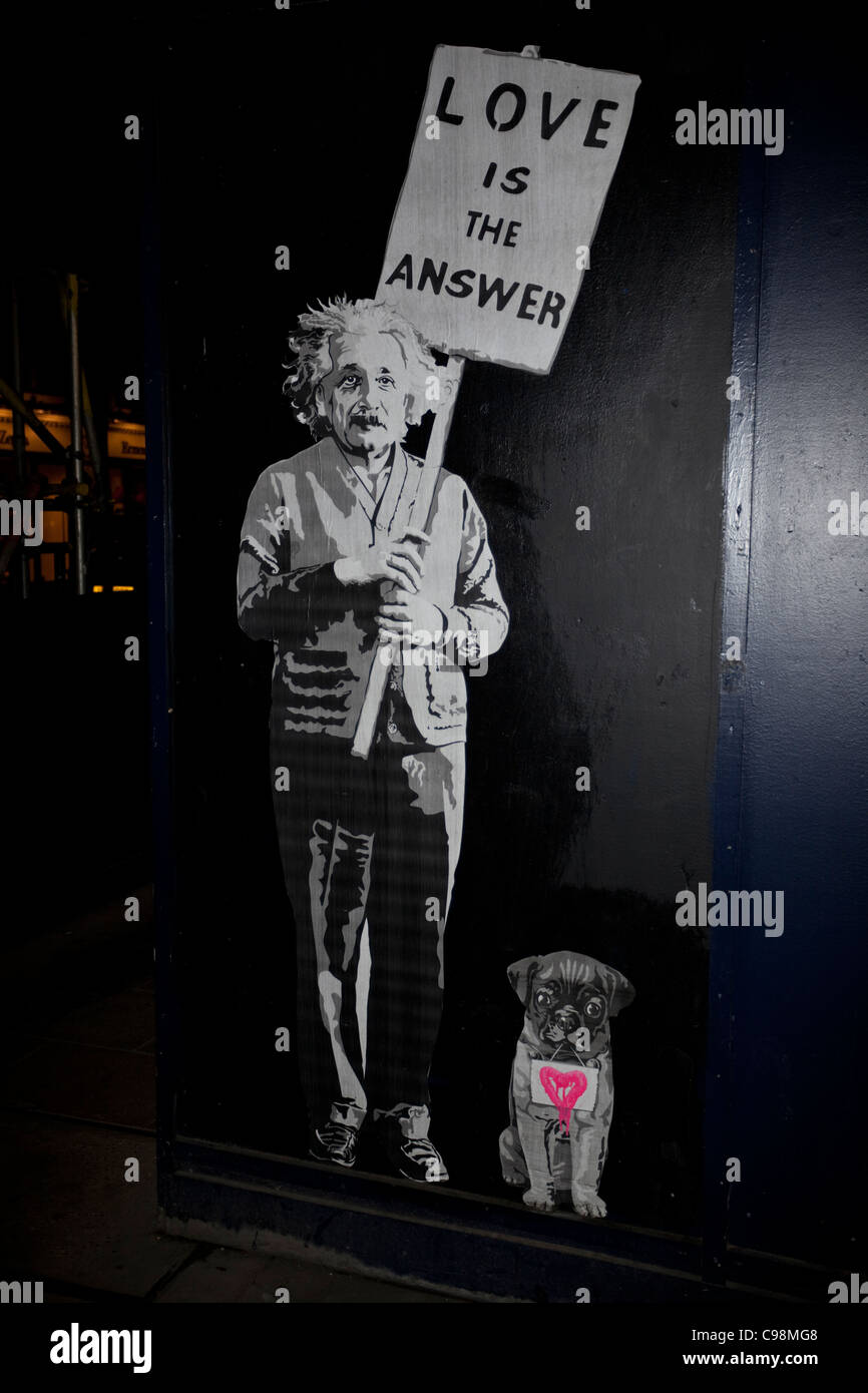 'Love is the Answer' stencil graffiti, London, England, UK. - Stock Image