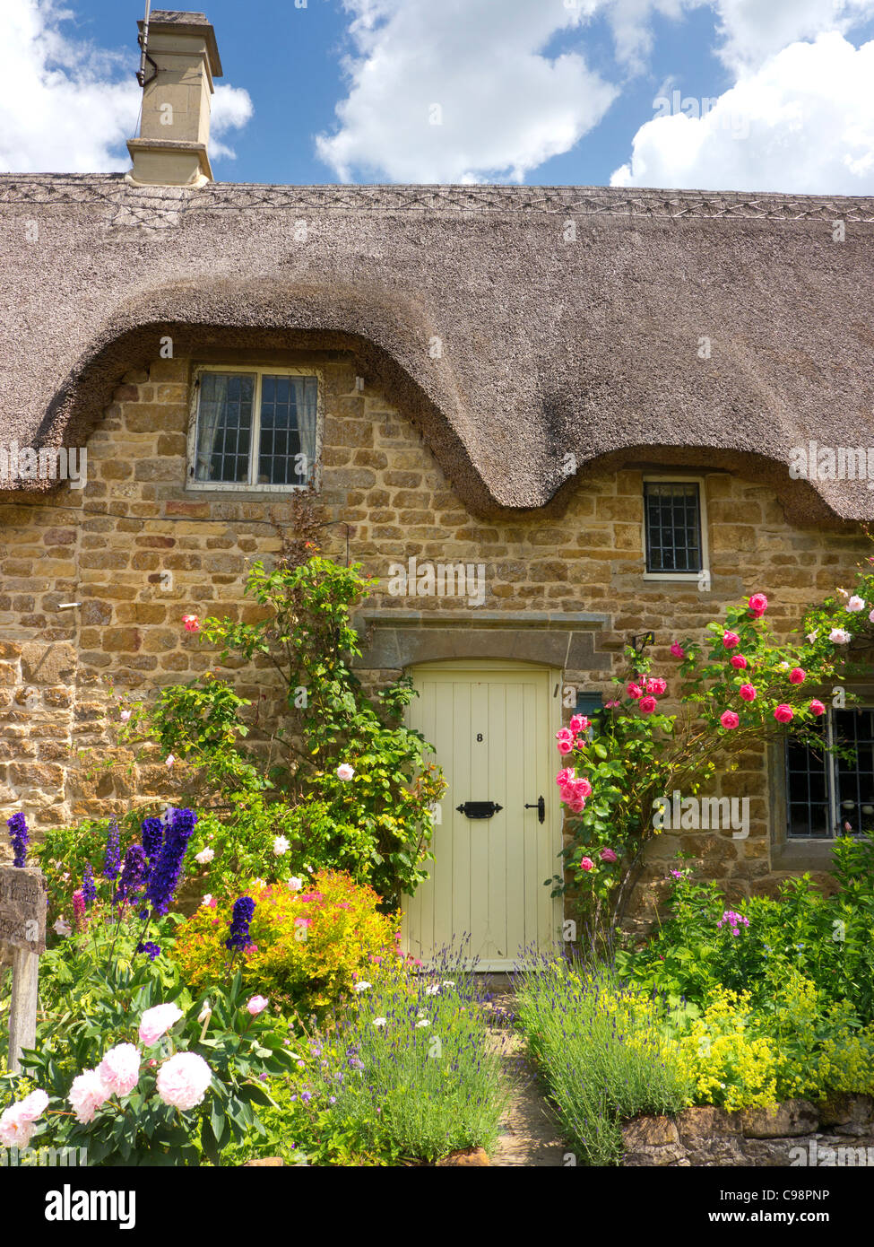 Detail of Thatched cottage, Cotswolds, Gloucestershire, England - Stock Image