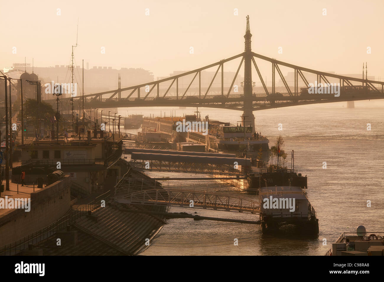 Budapest, Quayside on Danube River and Freedom Bridge at Sunrise - Stock Image