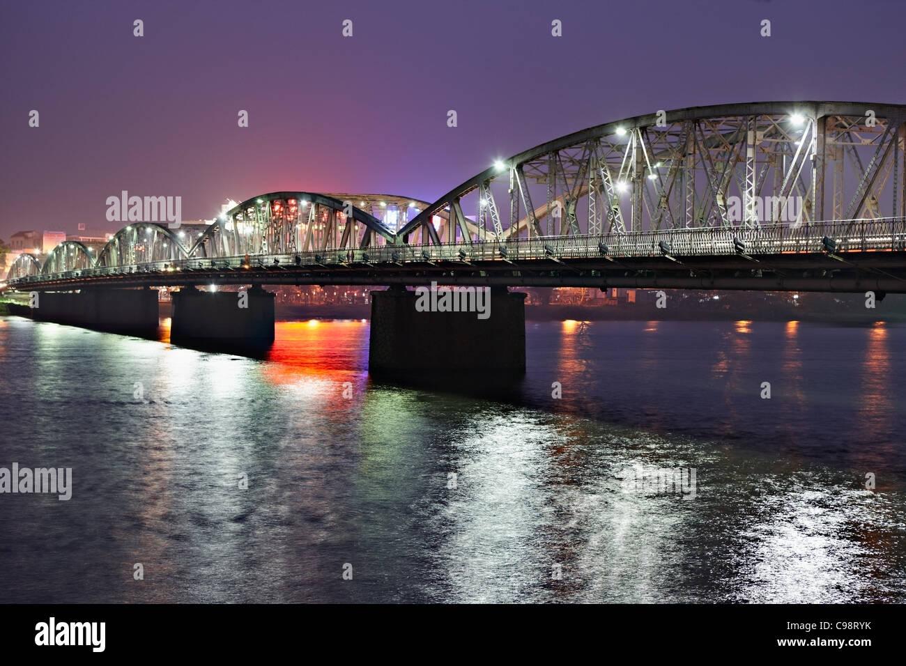 Illuminated Trang Tien Bridge over Perfume River, Hue, Vietnam - Stock Image