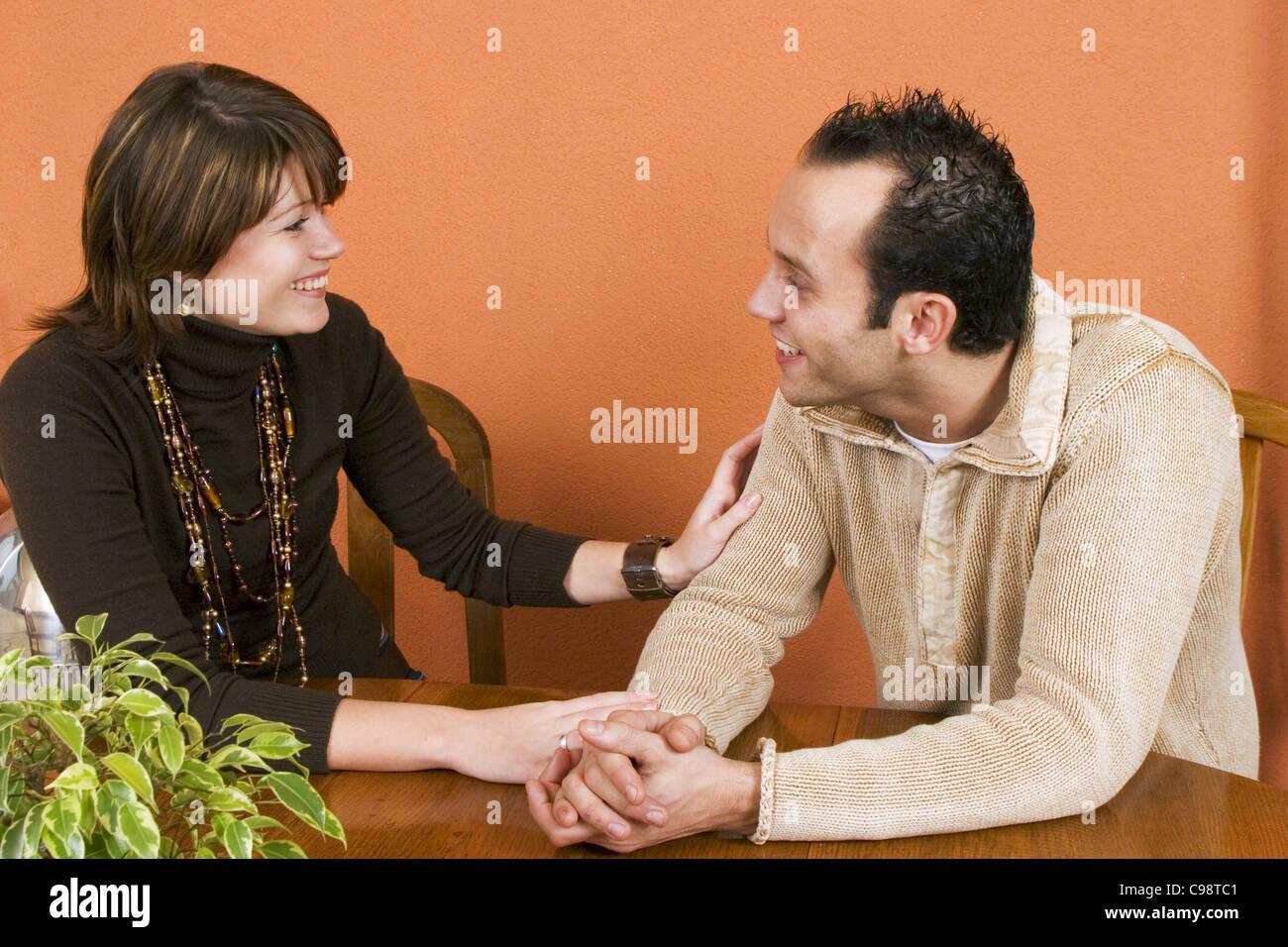 Happy couple talking - Stock Image