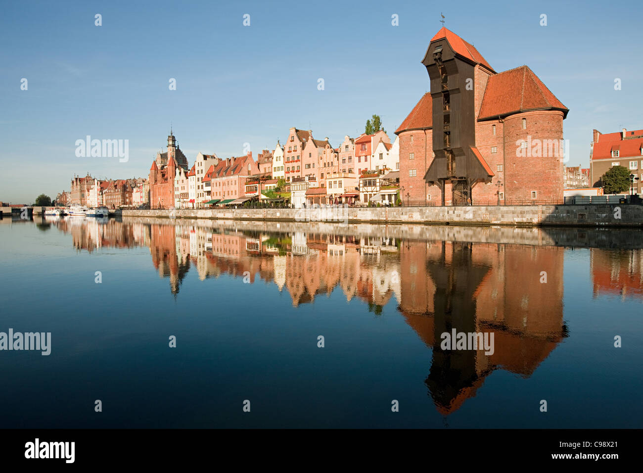 Medieval buildings reflected in water, Gdansk, Poland - Stock Image