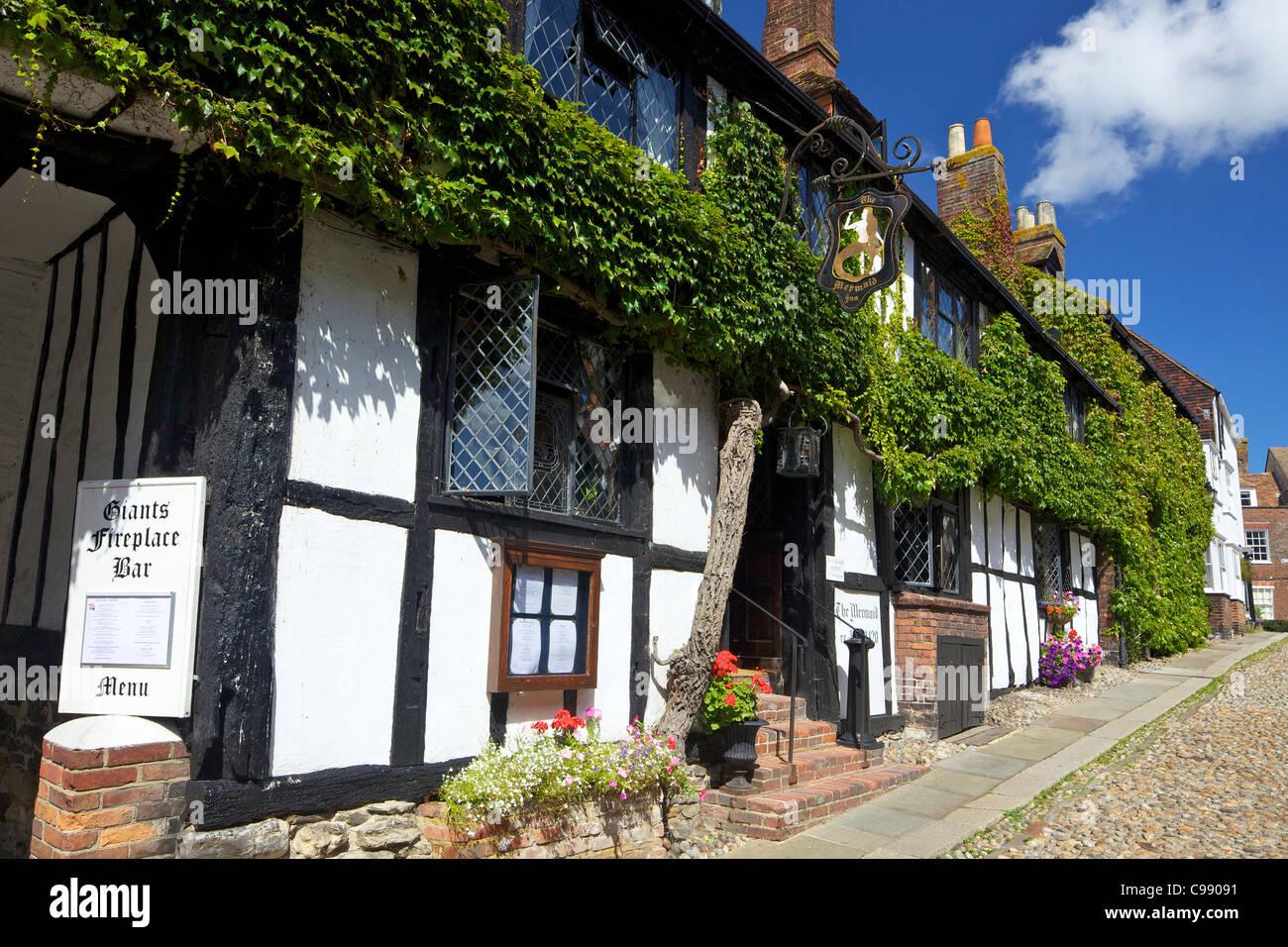 The Mermaid Inn, Mermaid Street in summer sunshine, Rye, East Sussex, England, UK, United Kingdom, GB, Great Britain, - Stock Image