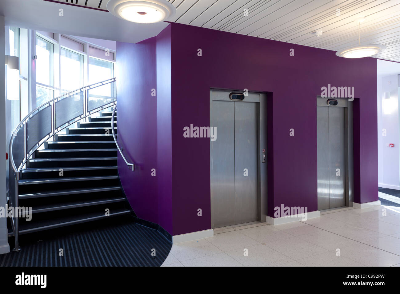 Entrance foyer and curved stair case and lift doors of the Eastpoint Centre, Southampton - Stock Image