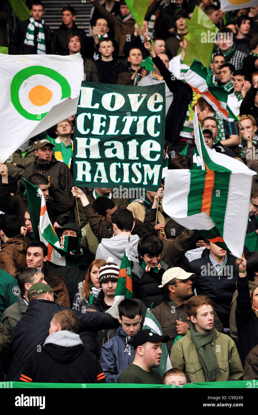 Celtic fans hold up anti-racism banners at Scottish League Cup Final, March 2011. - Stock Image