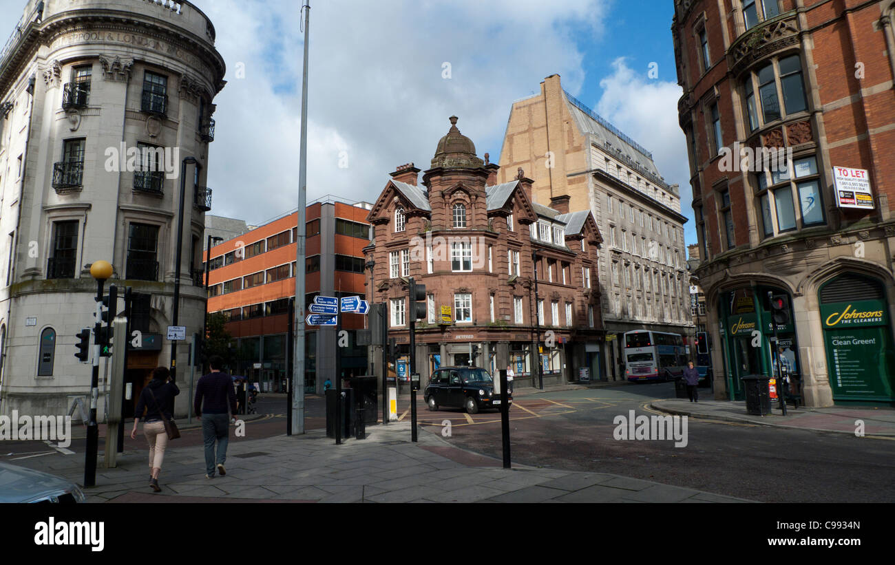 Pedestrians walking along a Manchester street England UK - Stock Image