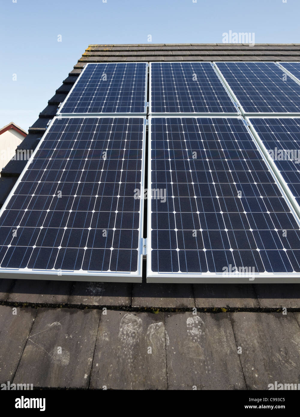 UK, Britain, Europe. Close-up of solar panels on a house roof. Stock Photo