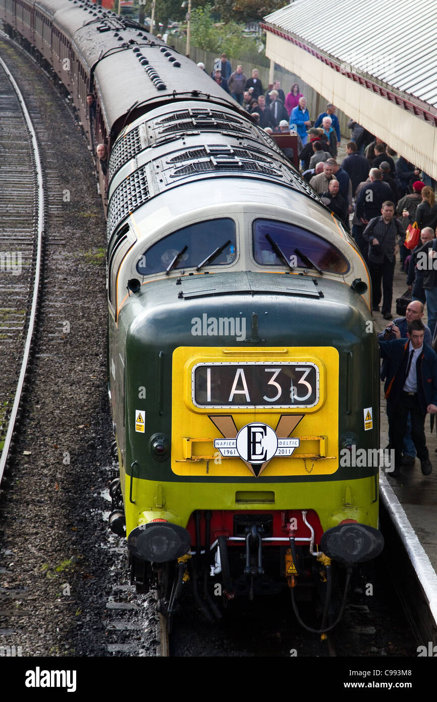 1A33 Deltic diesel Train and carriages, crowded train platform with passengers at Ramsbottom Station, East Lancashire Stock Photo