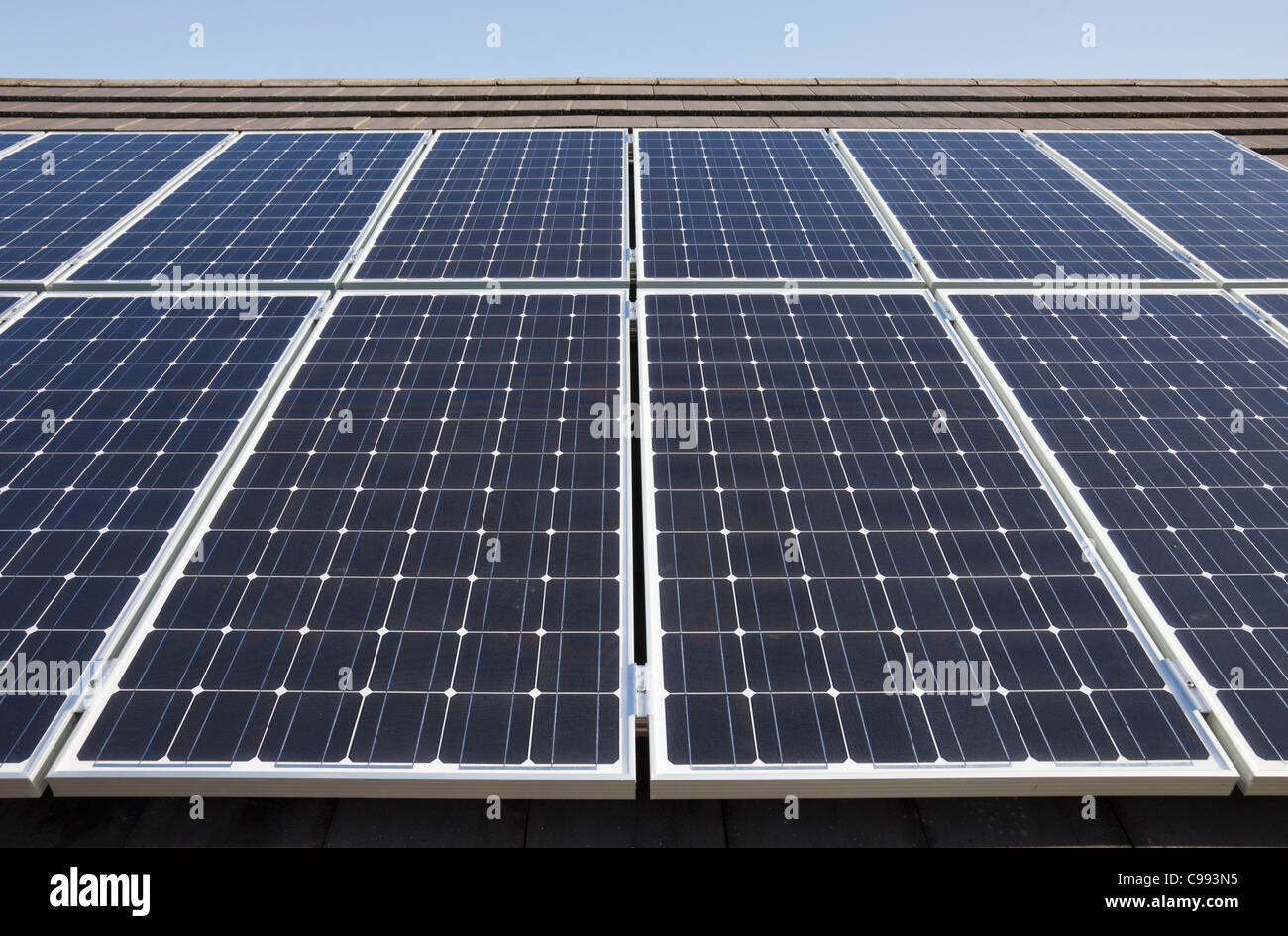 Close-up of solar panels on an energy efficient house roof. UK, Britain, Europe. - Stock Image