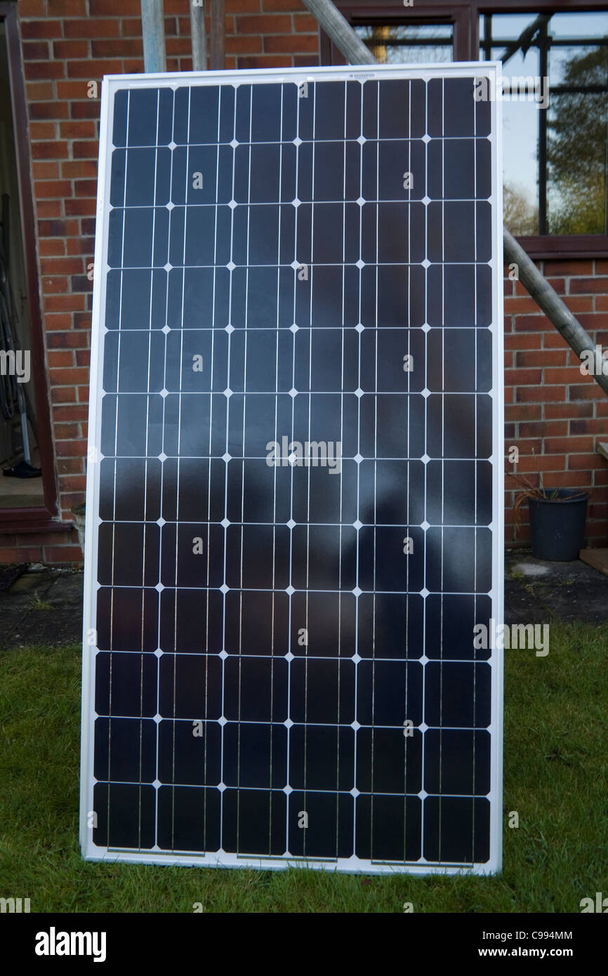 UK Solar panel leaned against scaffolding to be carried for fitting on house roof - Stock Image