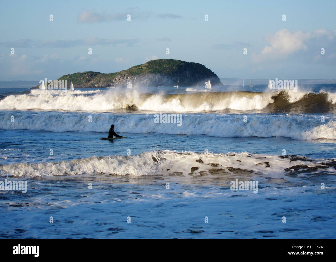 Crashing waves on the coast at North Berwick, Scotland in November. Craigleith Island is in the background. - Stock Image
