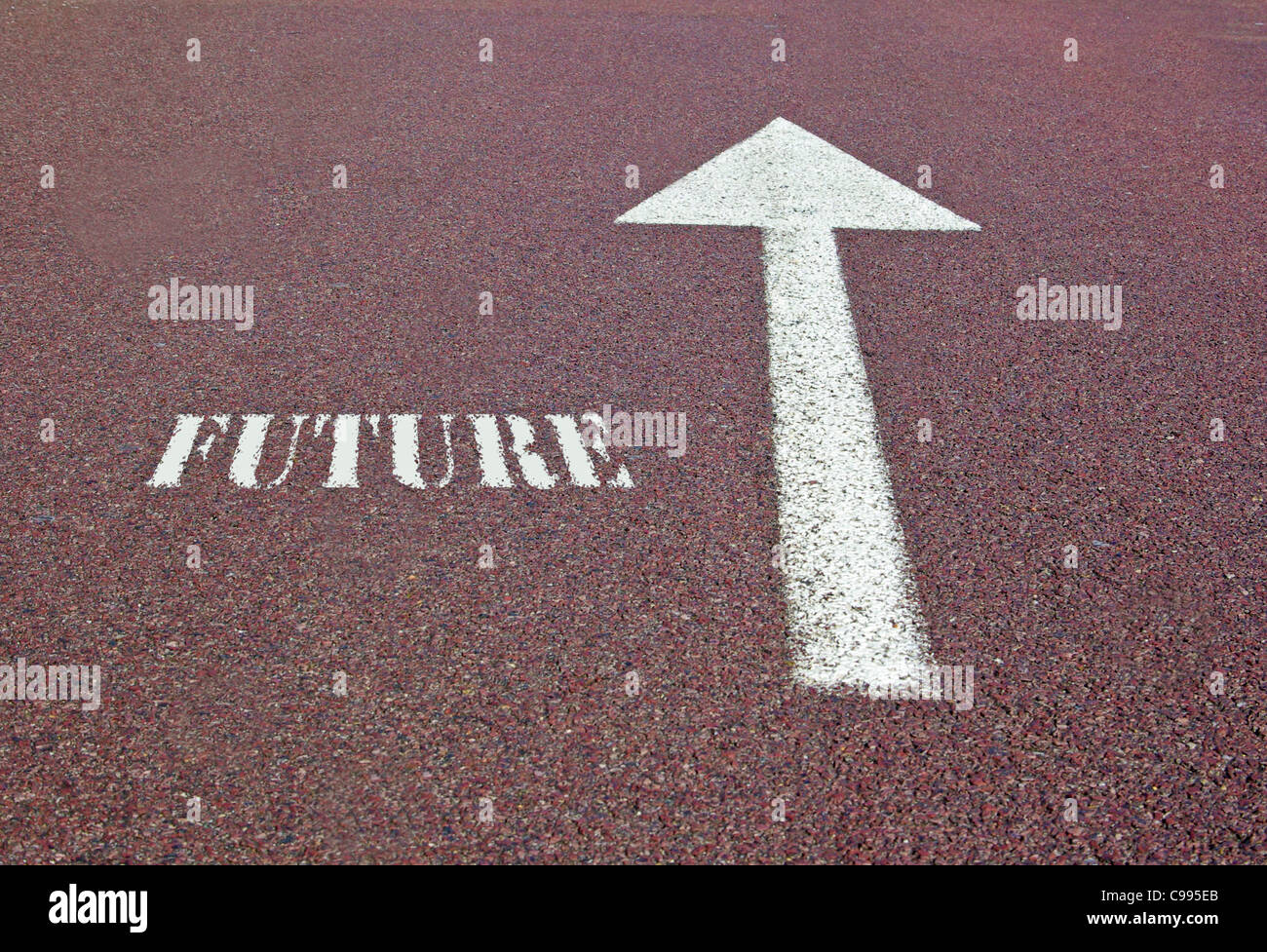 an arrow on the asphalt showing the future direction - Stock Image