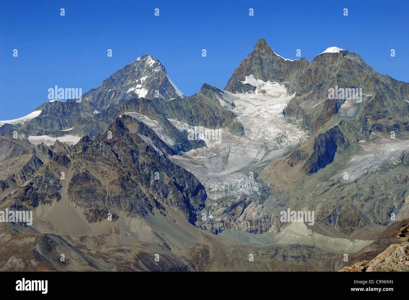 Dent Blanche with its glaciers overlooks the village of Zermatt in the canton of Valais, Switzerland - Stock Image