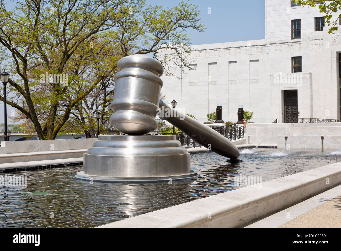 The Gavel, a stainless steel sculpture in the reflecting pool of the Ohio Judicial Center in Columbus, Ohio. - Stock Image