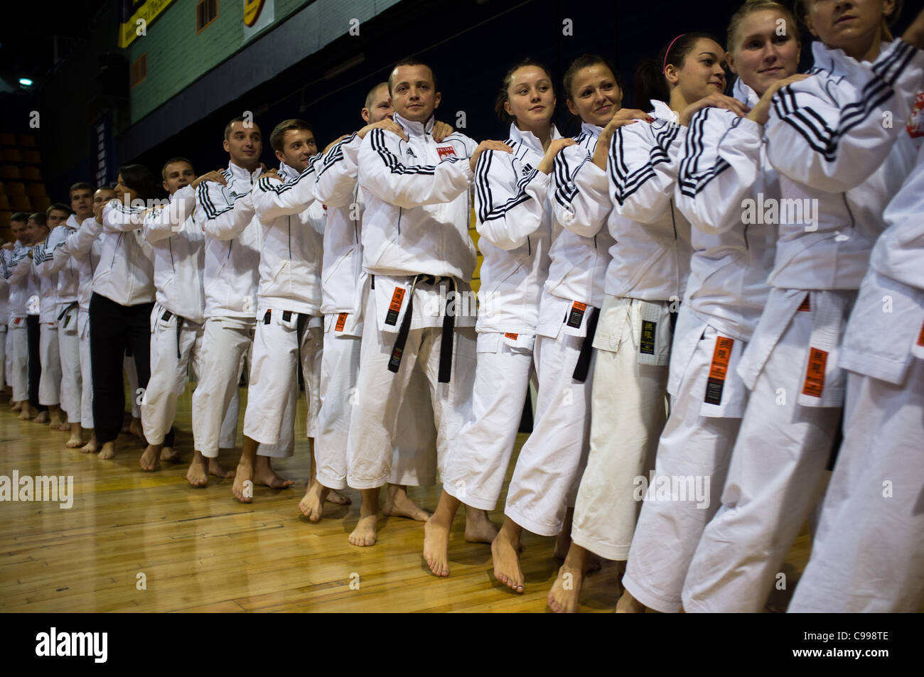 Polish team show comradeship and good spirits following the opening ceremony of the 2011 European Traditional Karate - Stock Image