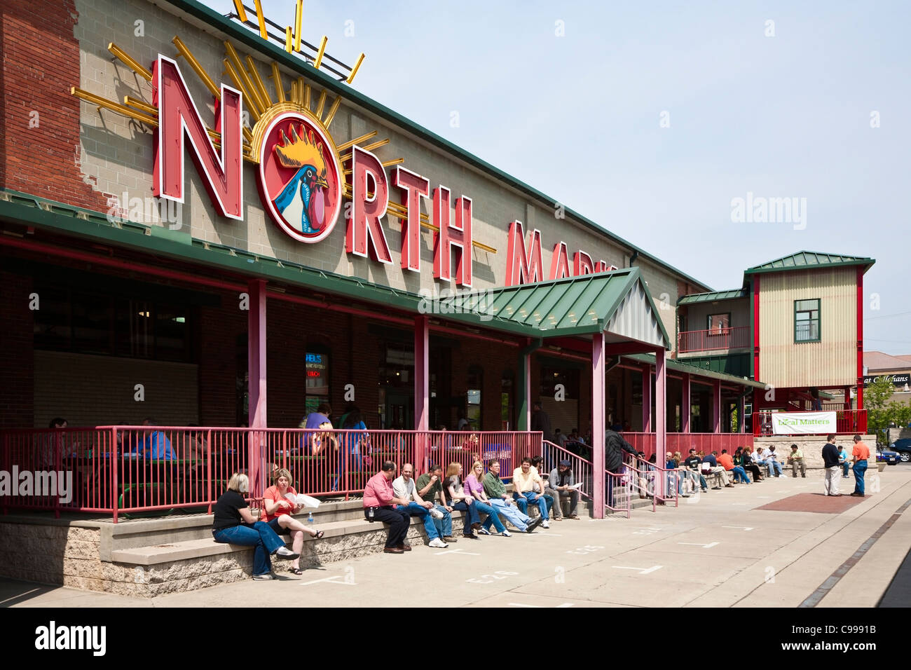 Local business people enjoy lunch at North Market public market in Columbus, Ohio. - Stock Image