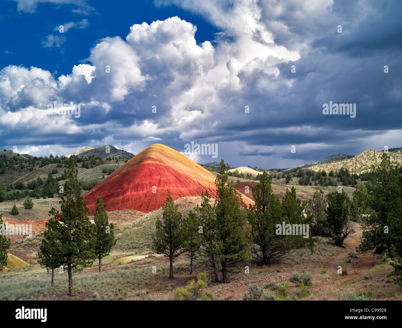 Red Hill and clouds. Painted Hills, John Day Fossil Beds National Monument, Oregon - Stock Image