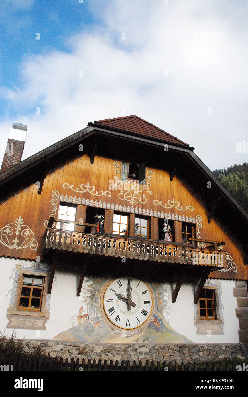 Giant cuckoo's clock on the wall of a traditional Black Forest house at Hofgut Sternen in Breitnau, Höllental, Baden Stock Photo