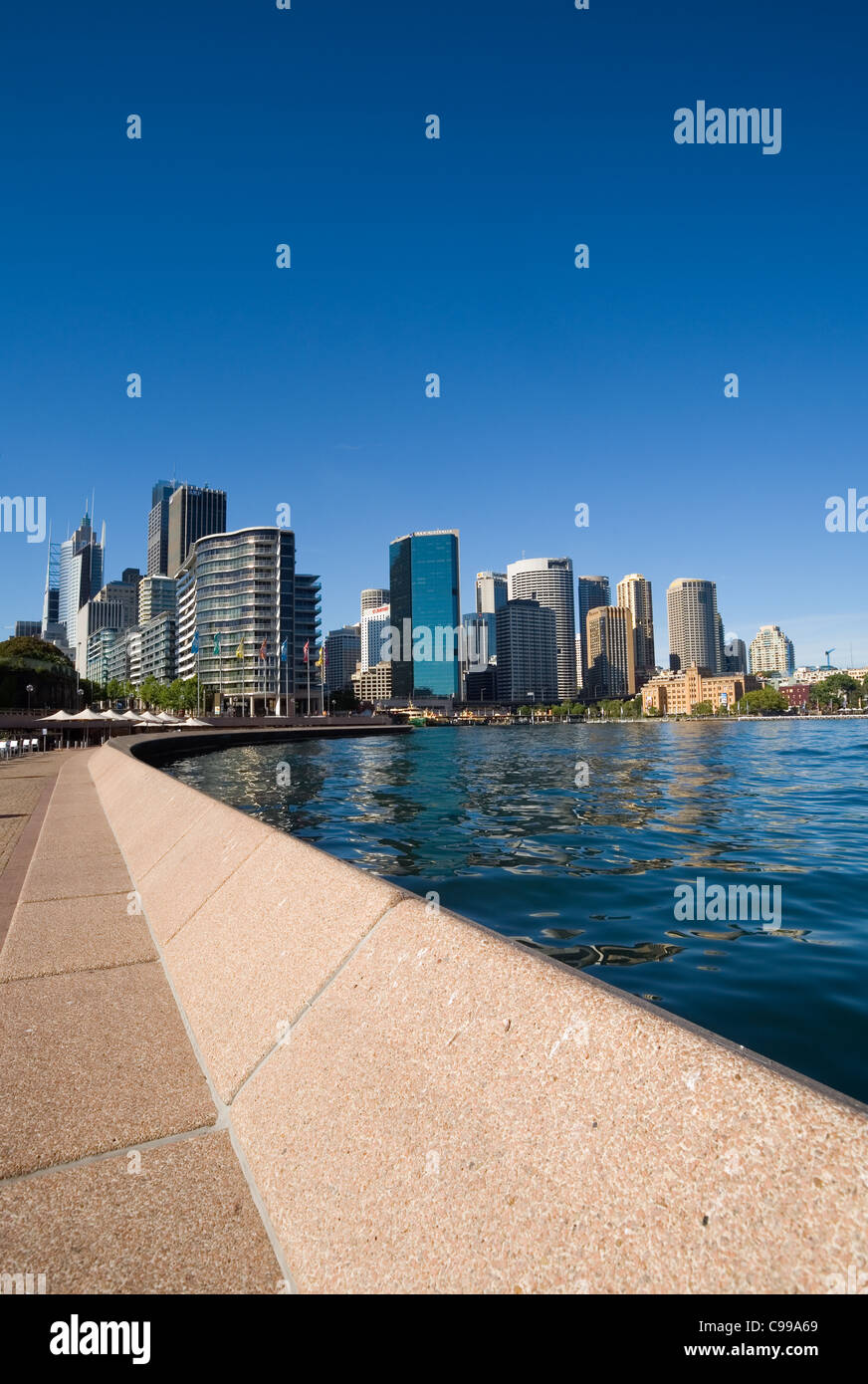 View along Sydney Cove waterfront towards Circular Quay and the city skyline. Sydney, New South Wales, Australia - Stock Image