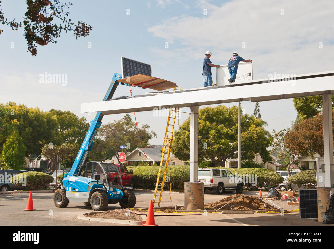 Solar Panels being installed on the roof of a parking pavilion at the Fullerton Public Library in California. - Stock Image