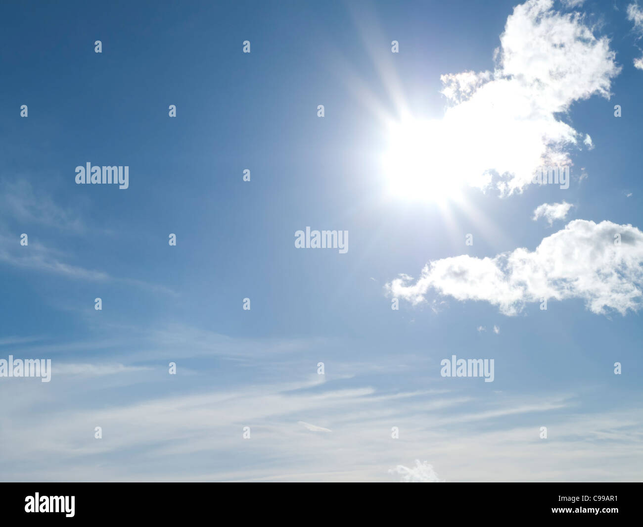 Sun in Cloudy Sky - Stock Image