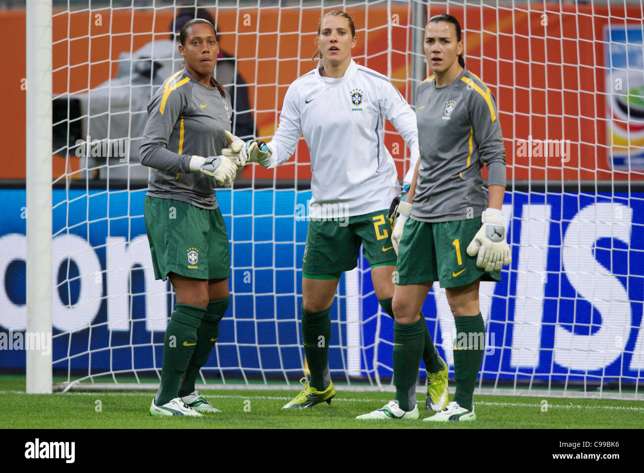 Brazil goalkeepers Barbara, Thais and Andreia (L-R) warm up before a 2011 FIFA Women's World Cup Group D match - Stock Image