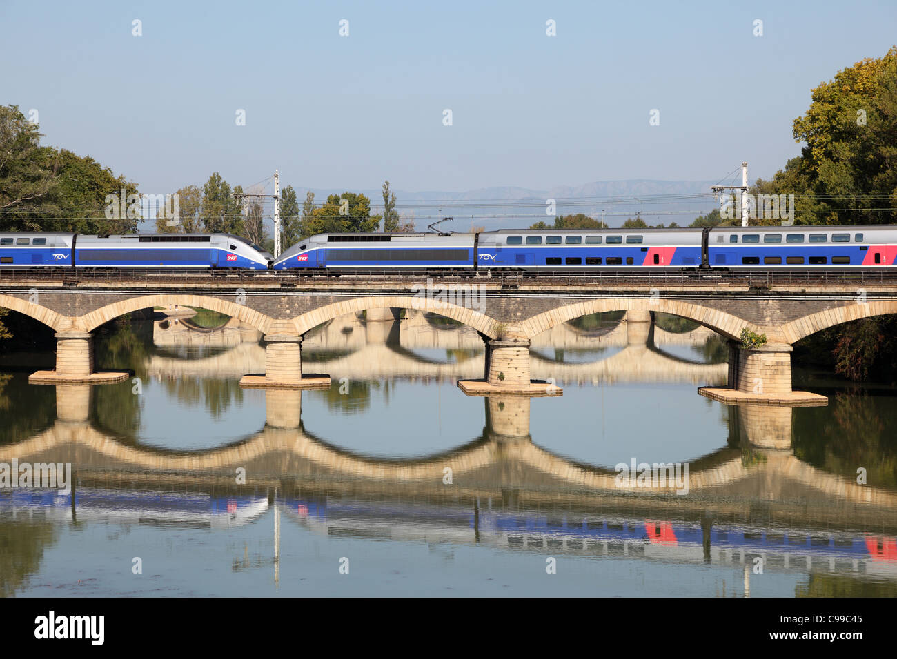 French high speed train TGV crossing the bridge in Beziers, France - Stock Image