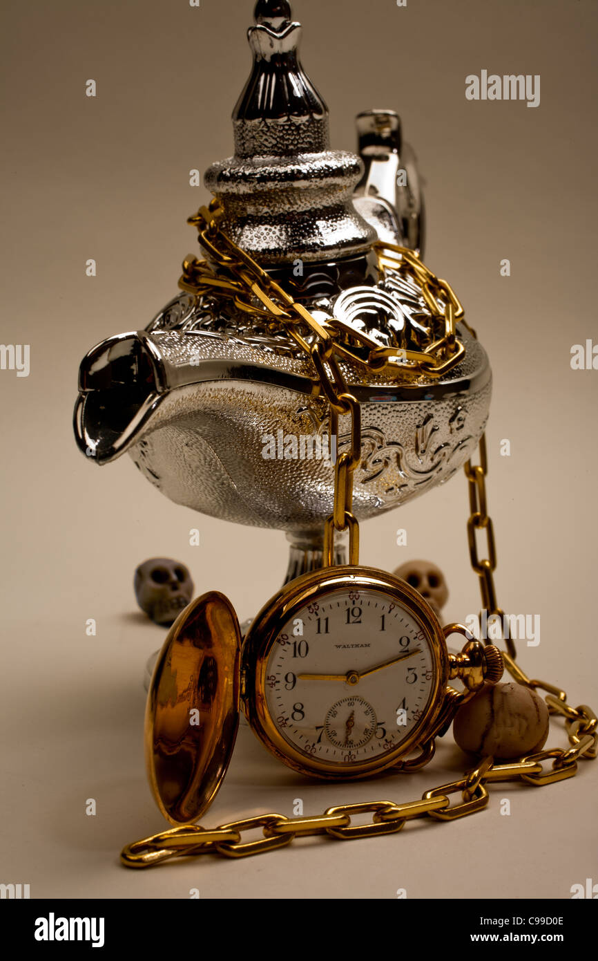 Silver Magic Lamp with Gold Pocket Watch - Stock Image