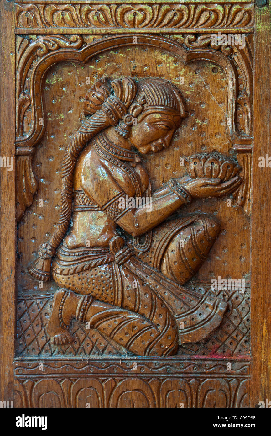 Indian Woman Devotee Offering Lotus Flower Wood Carving India