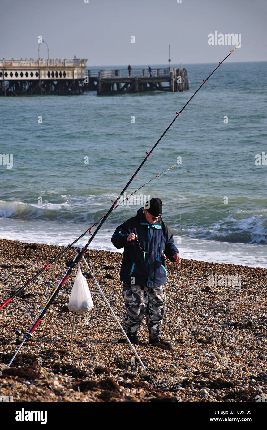 Fishing on beach by South Parade Pier, Southsea, Portsmouth, Hampshire, England, United Kingdom Stock Photo