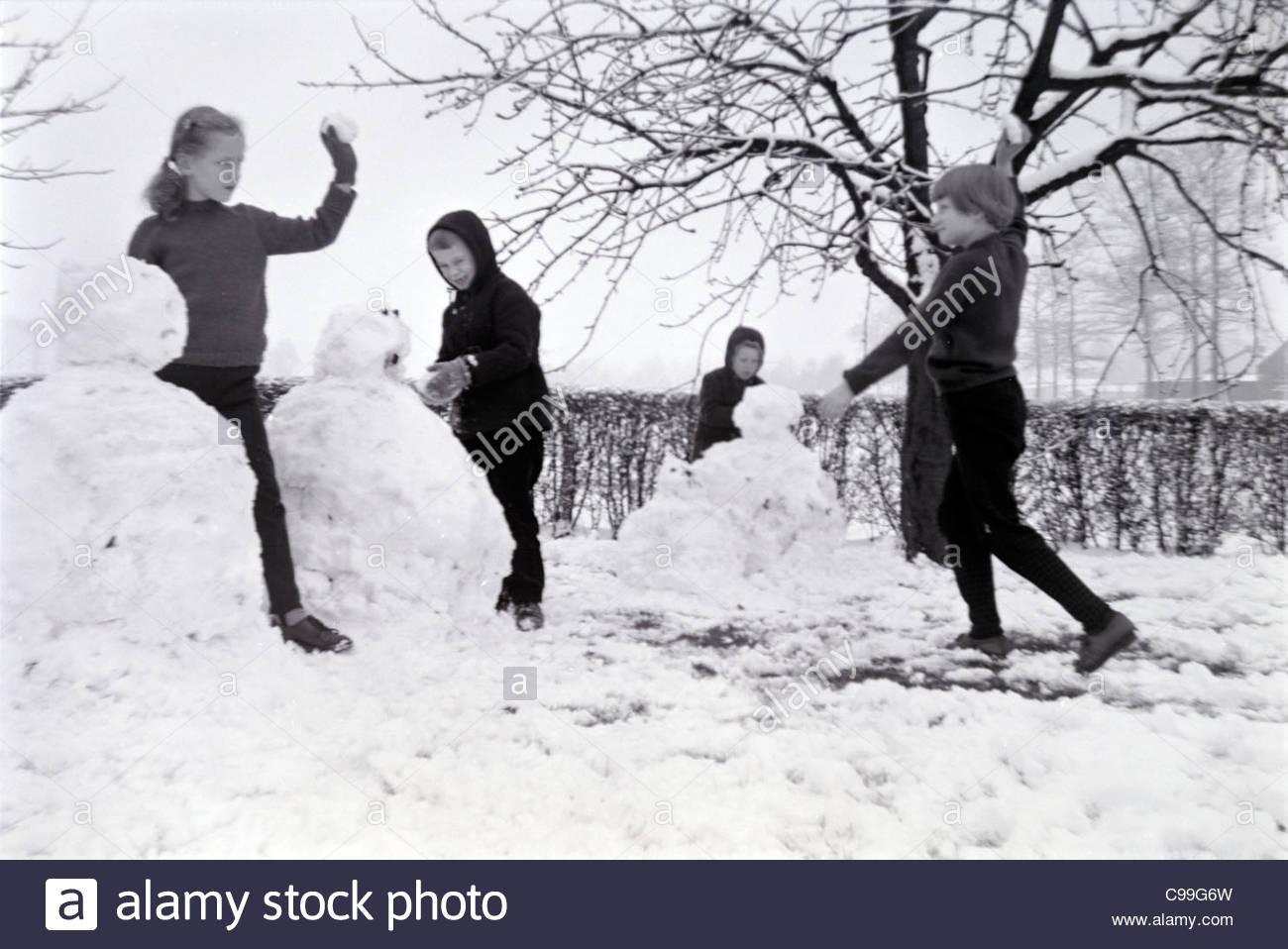 children playing in the snow 1960s - Stock Image