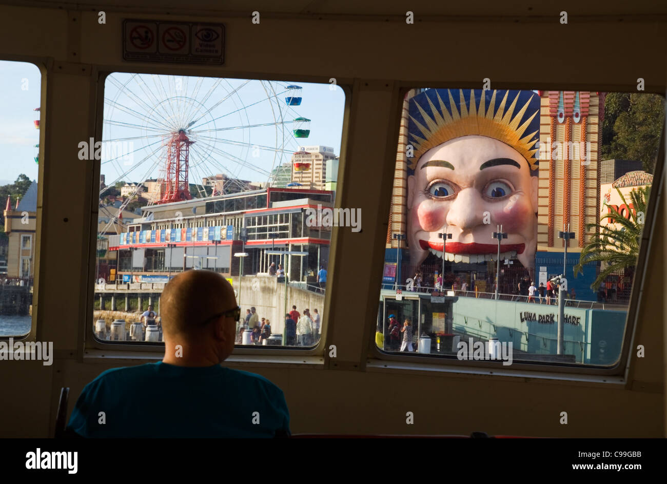 View of Luna Park from the window of a Sydney Ferry.  Milsons Point, Sydney, New South Wales, Australia - Stock Image