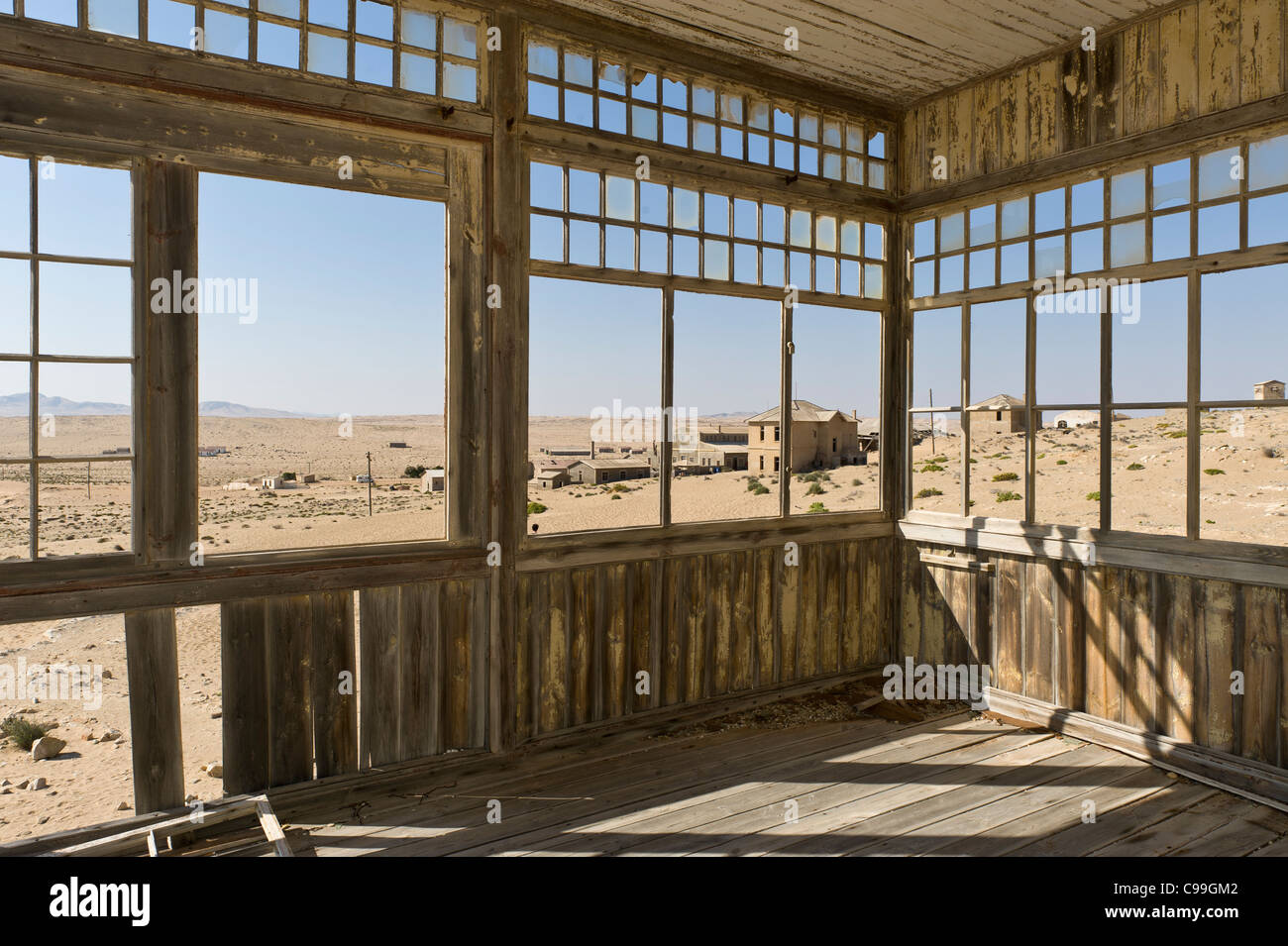 View from the veranda of an abandoned building in Kolmanskop a former diamond mine in Namibia - Stock Image