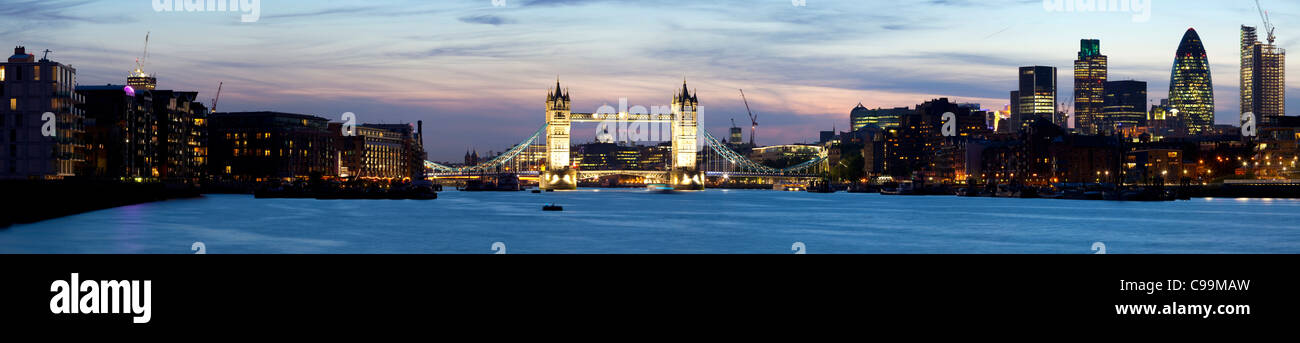 Tower bridge viewed over the river Thames at dusk - Stock Image