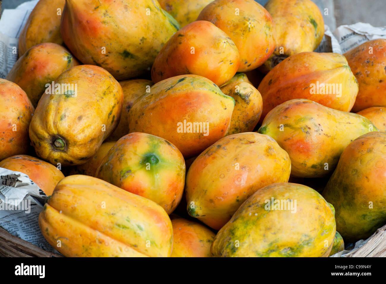 Papaya for sale at an Indian market - Stock Image