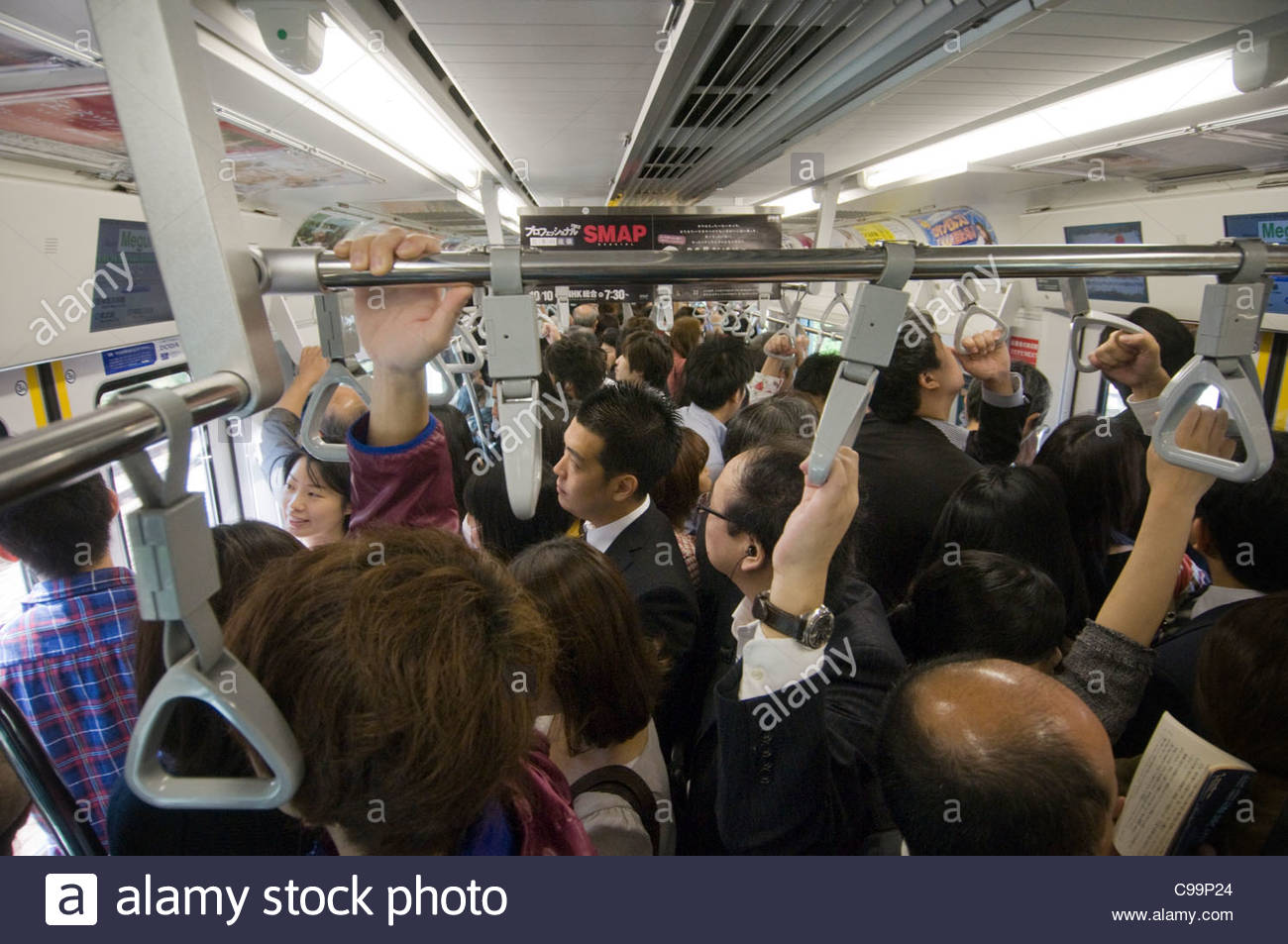 Commuters in a crowded Tokyo train Tokyo Japan - Stock Image