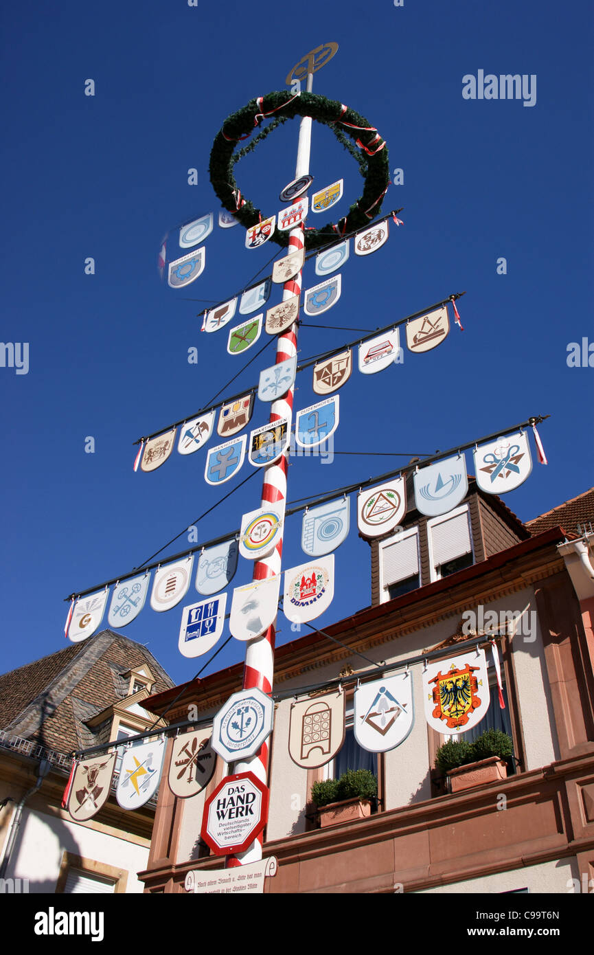 'Zunftbaum' pole showing the guild signs of trade guilds, Speyer, Rheinland-Pfalz, Germany - Stock Image